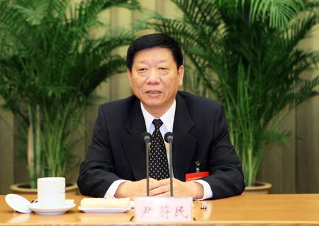 尹蔚民部长在会上作工作报告